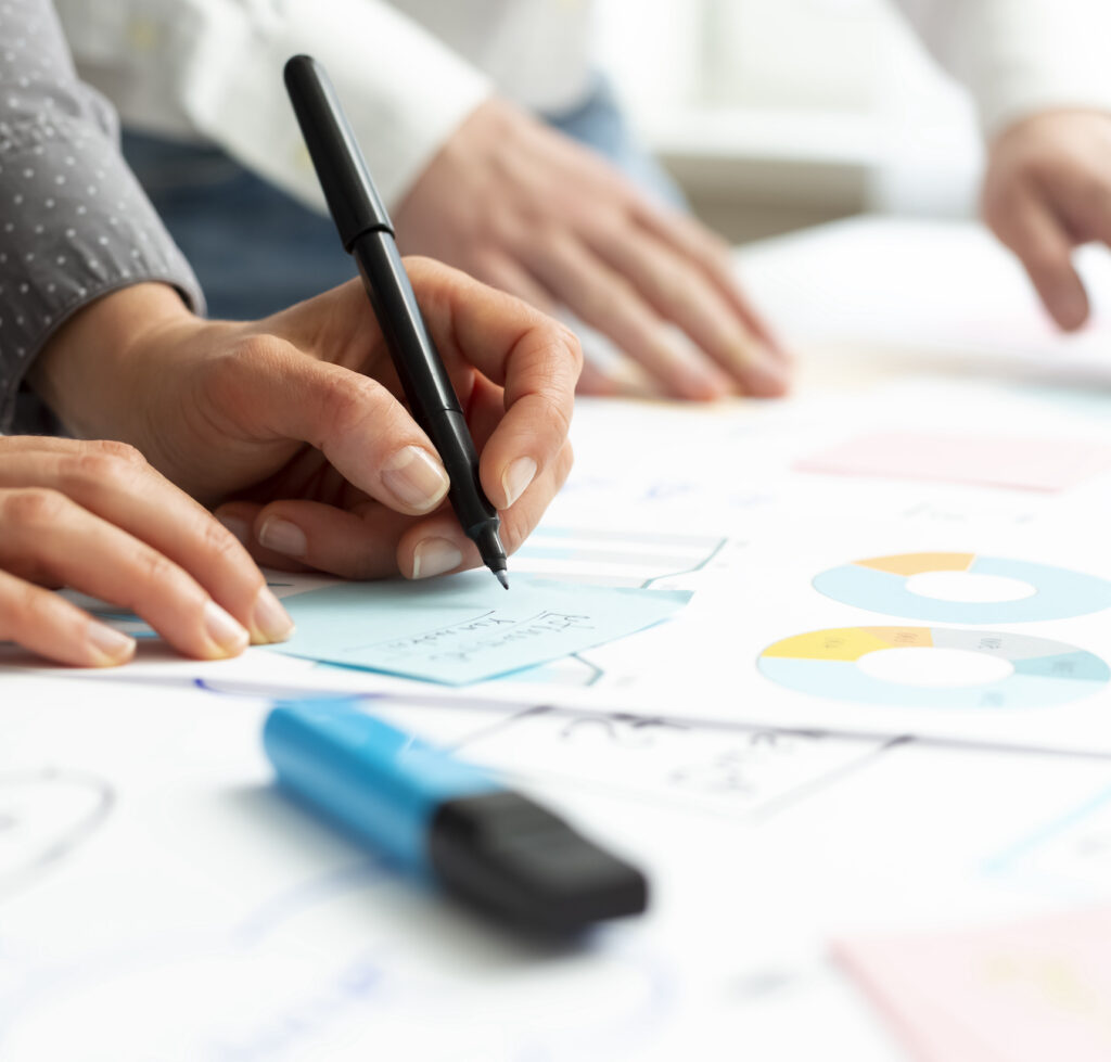 Business people hands do chart analysis and statistics. Marketing metrics planning. Colleagues discuss financial charts. Brainstorm the team.